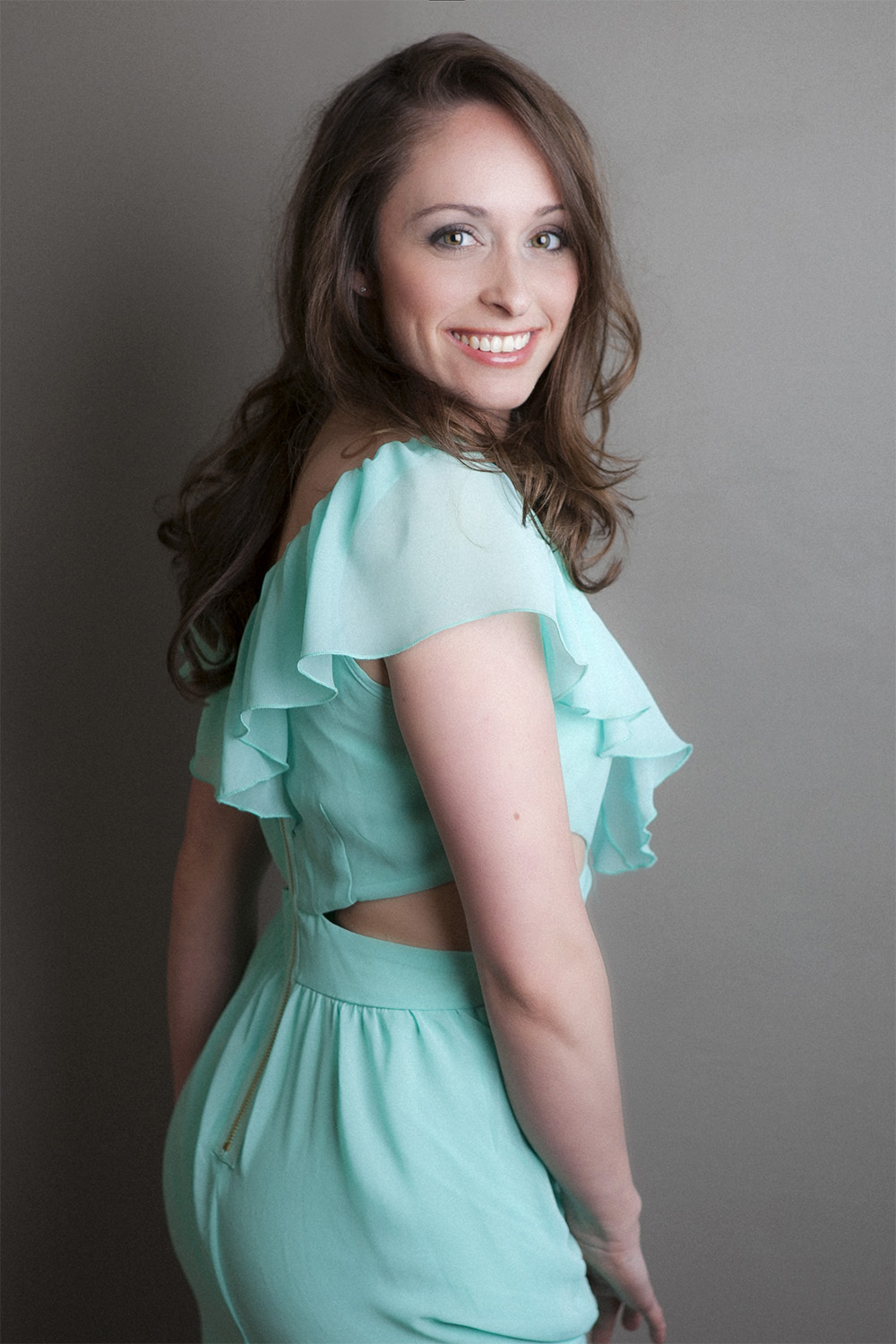 Glamour photographer in Massachusetts, gorgeous woman in a green girly dress smiling big to the camera