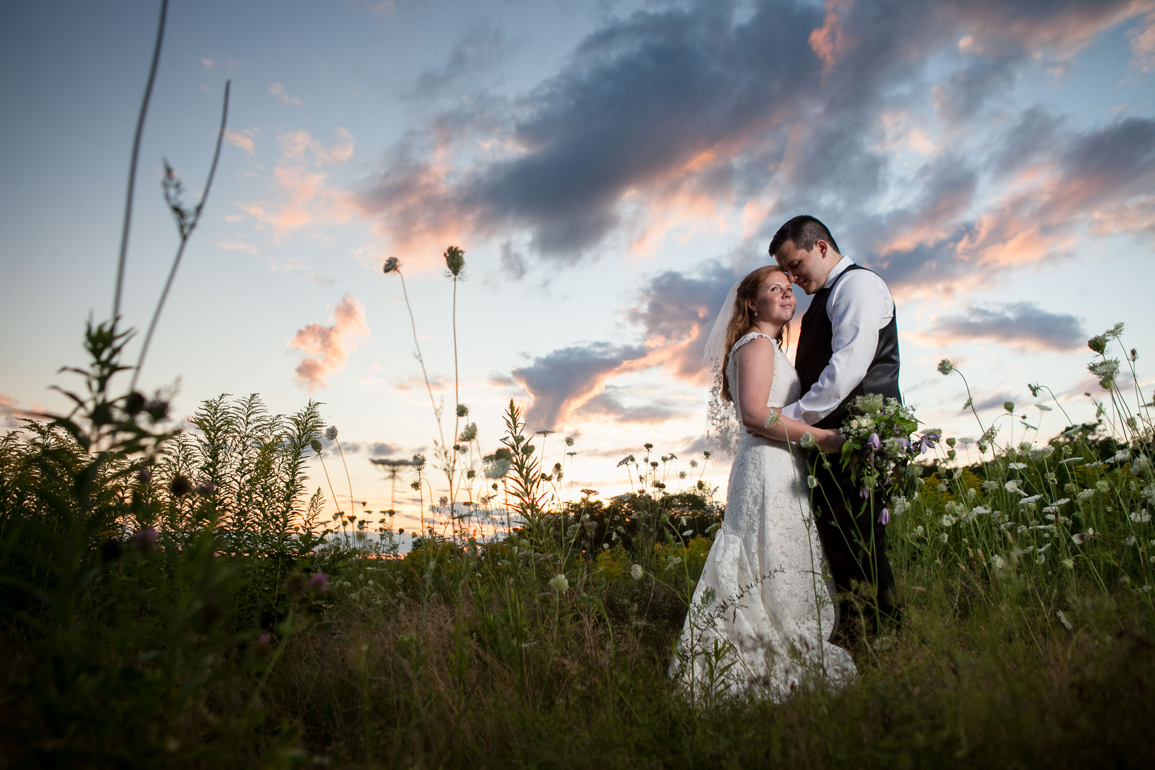 sunset skies are gorgeous for couples session at Harrington Farm Wedding