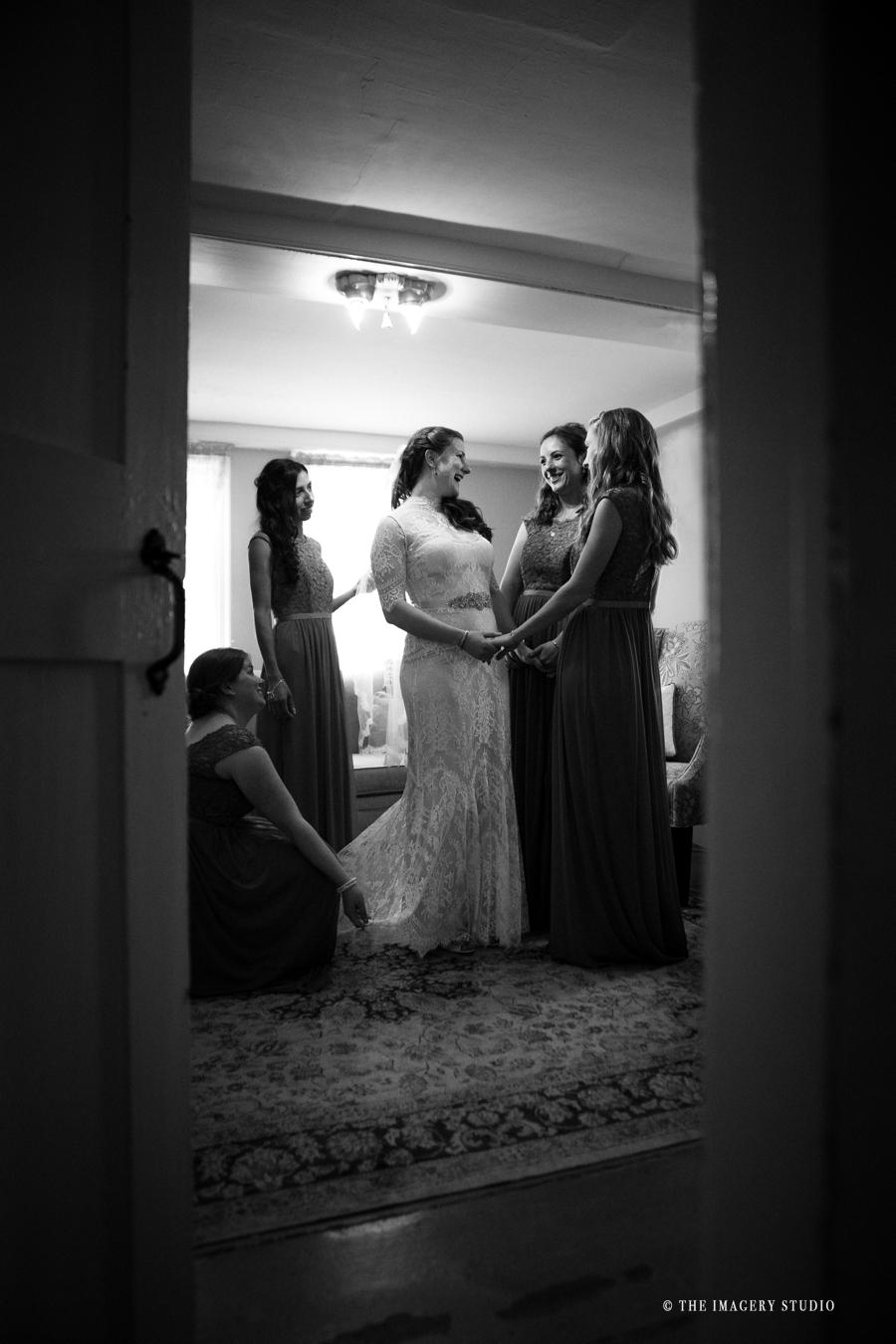 Bride getting ready with bridesmaids at a harrington farm wedding