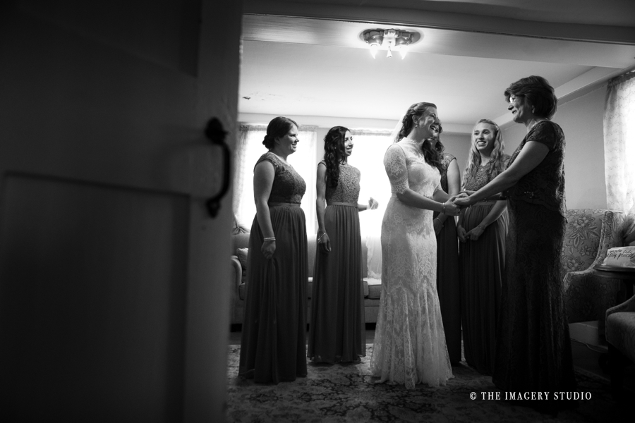 Bride getting ready with bridesmaids at a harrington farm weddings