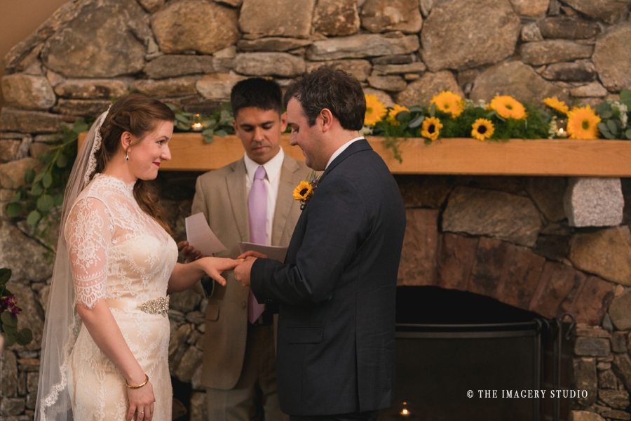 exchange rings at harrington farm wedding, in front of the fireplace