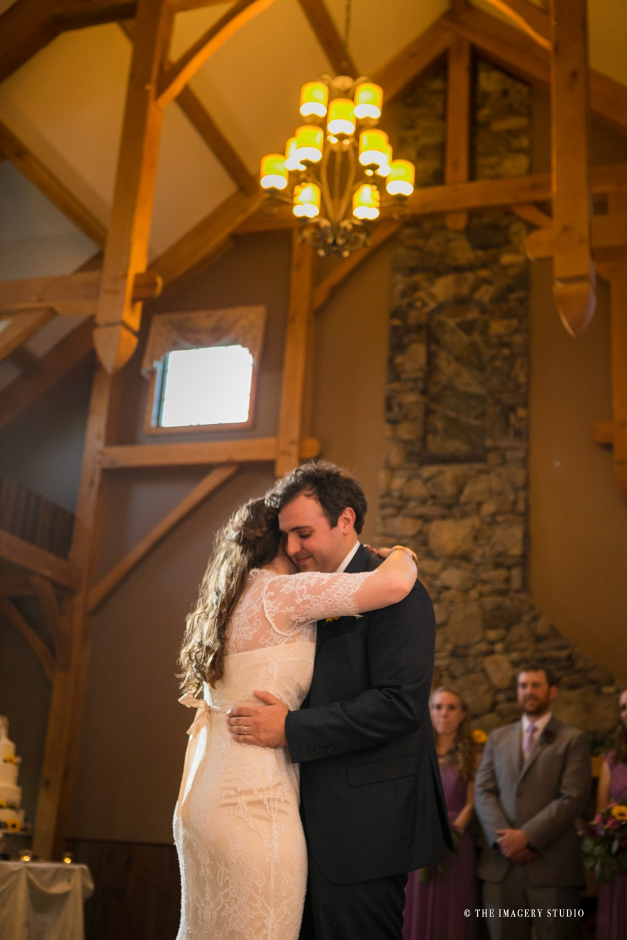 harrington farm weddings, bride and groom first dance in front of the fireplace