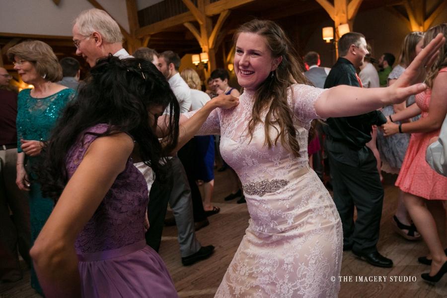 bride dancing at a harrington farm wedding