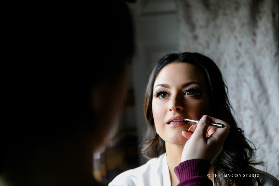 bride getting makeup done by S.R. Artistry