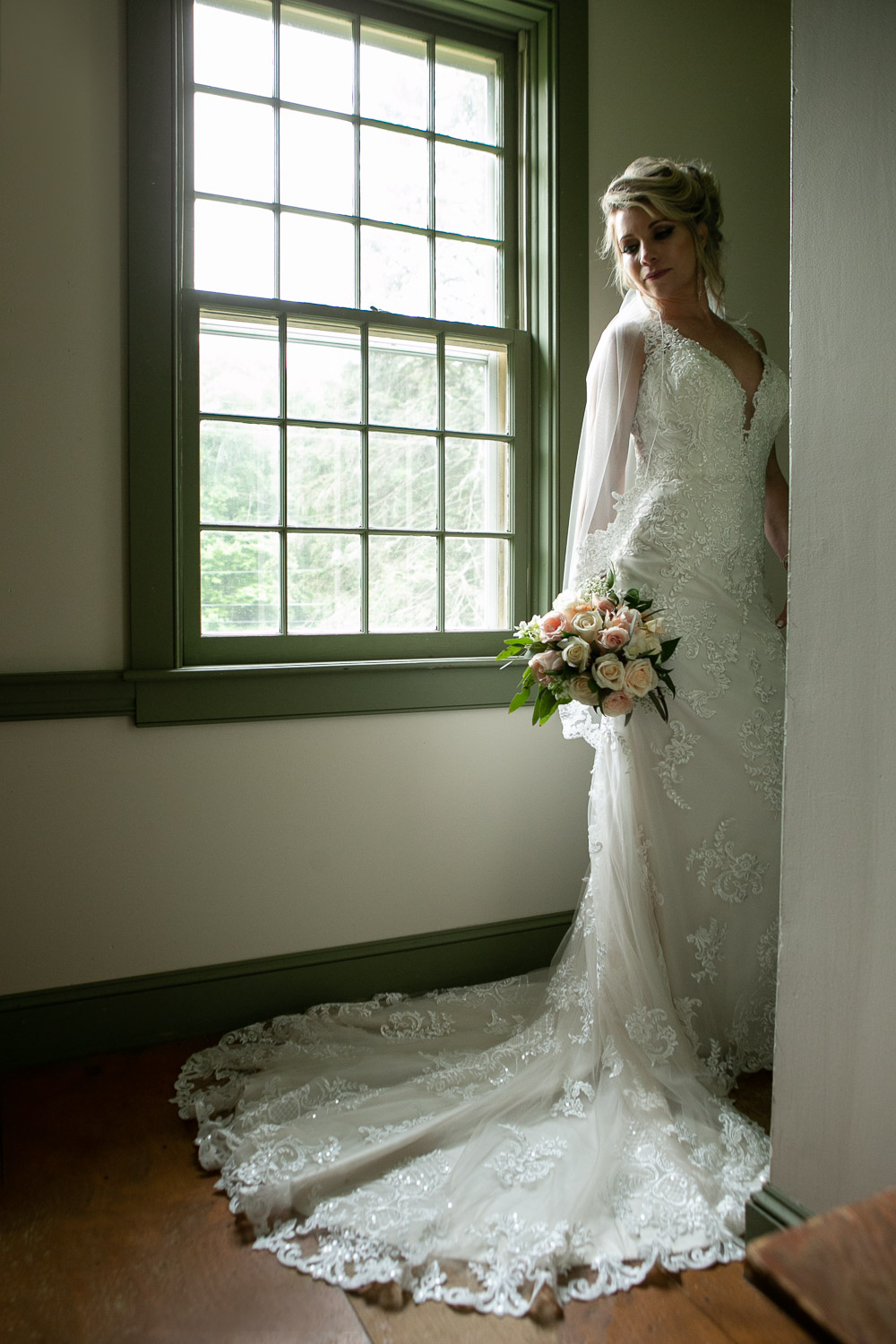 window portrait of a bride at Hartmans Herb Farm Wedding