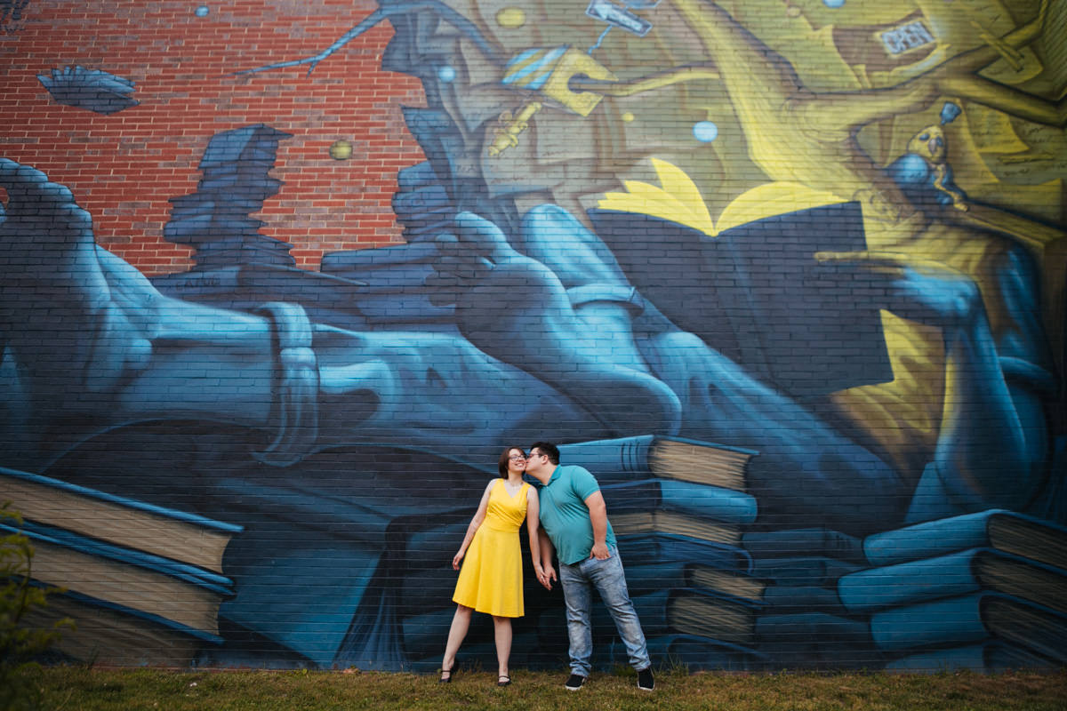 Fun Engagement Session in Worcester MA, books mural