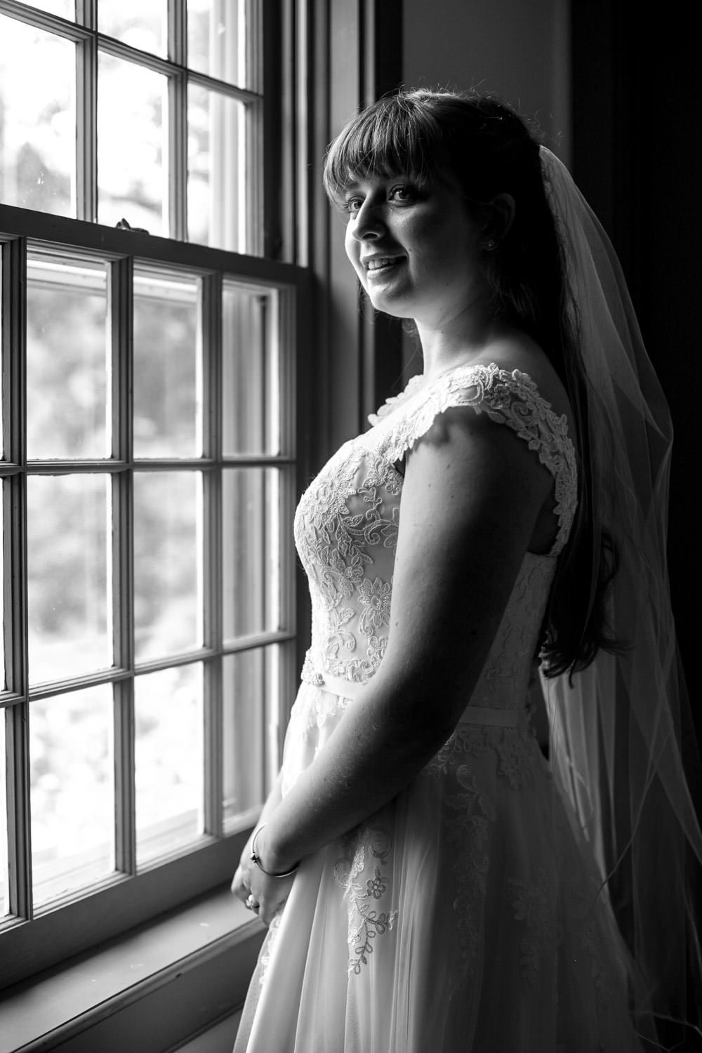 hartmans herb farm weddings, artistic BW photo of a bride by the window