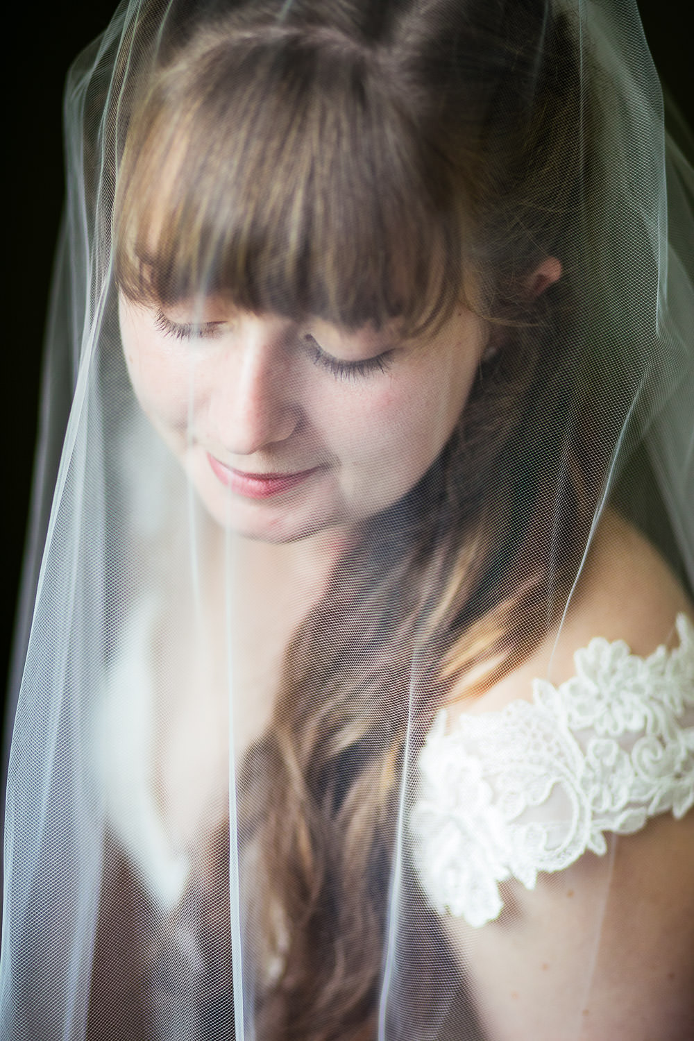 hartmans herb farm weddings, portrait of a bride with window light, by wedding photographer Alice pepplow