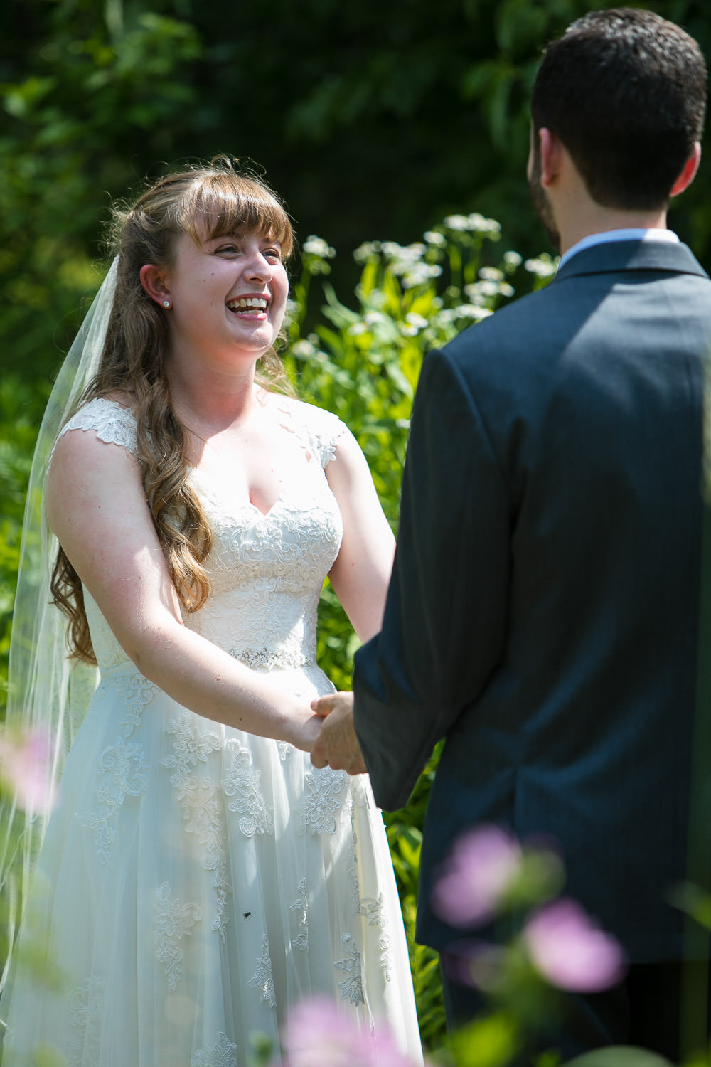 hartmans herb farm weddings, candid moment during a wedding ceremony, bride laughing