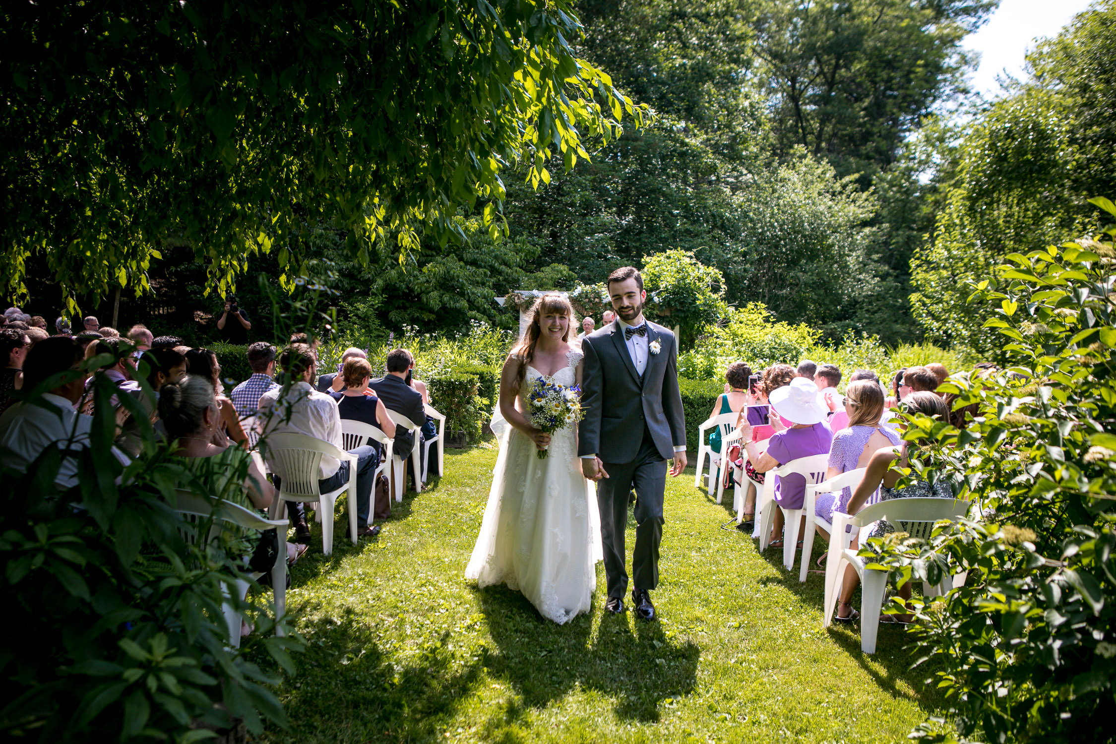 hartmans herb farm weddings, happy exit of bride and groom