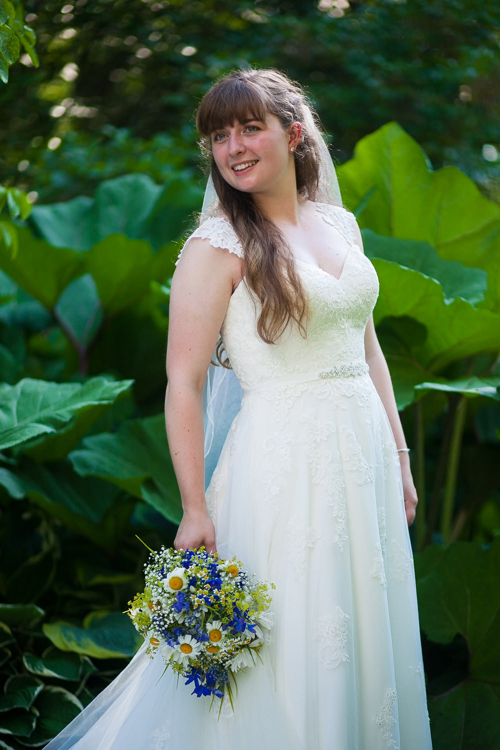 bride alone in the gardens hartmans herb farm weddings