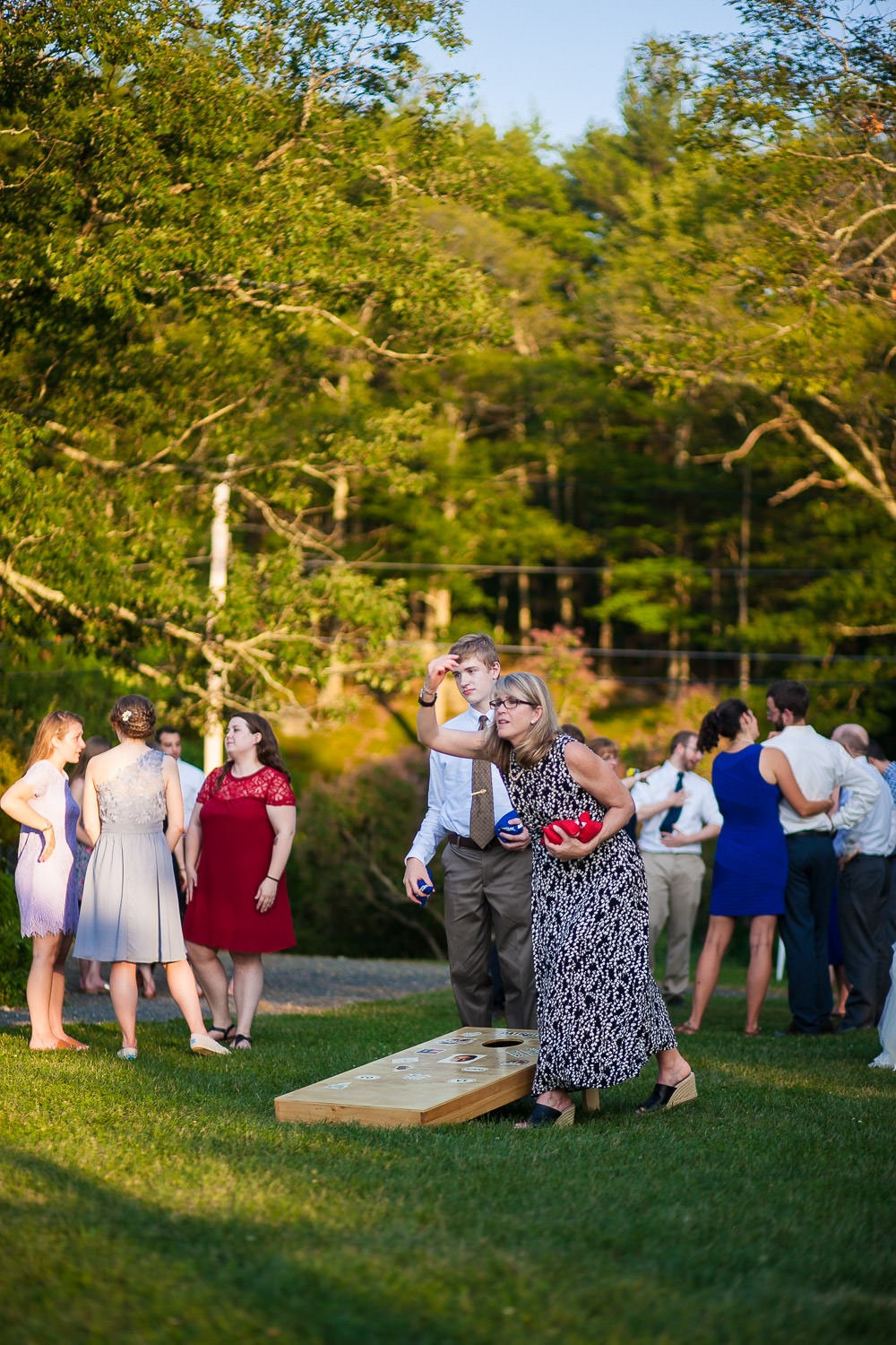 hartmans herb farm weddings, people enjoying the lawn games, casual wedding