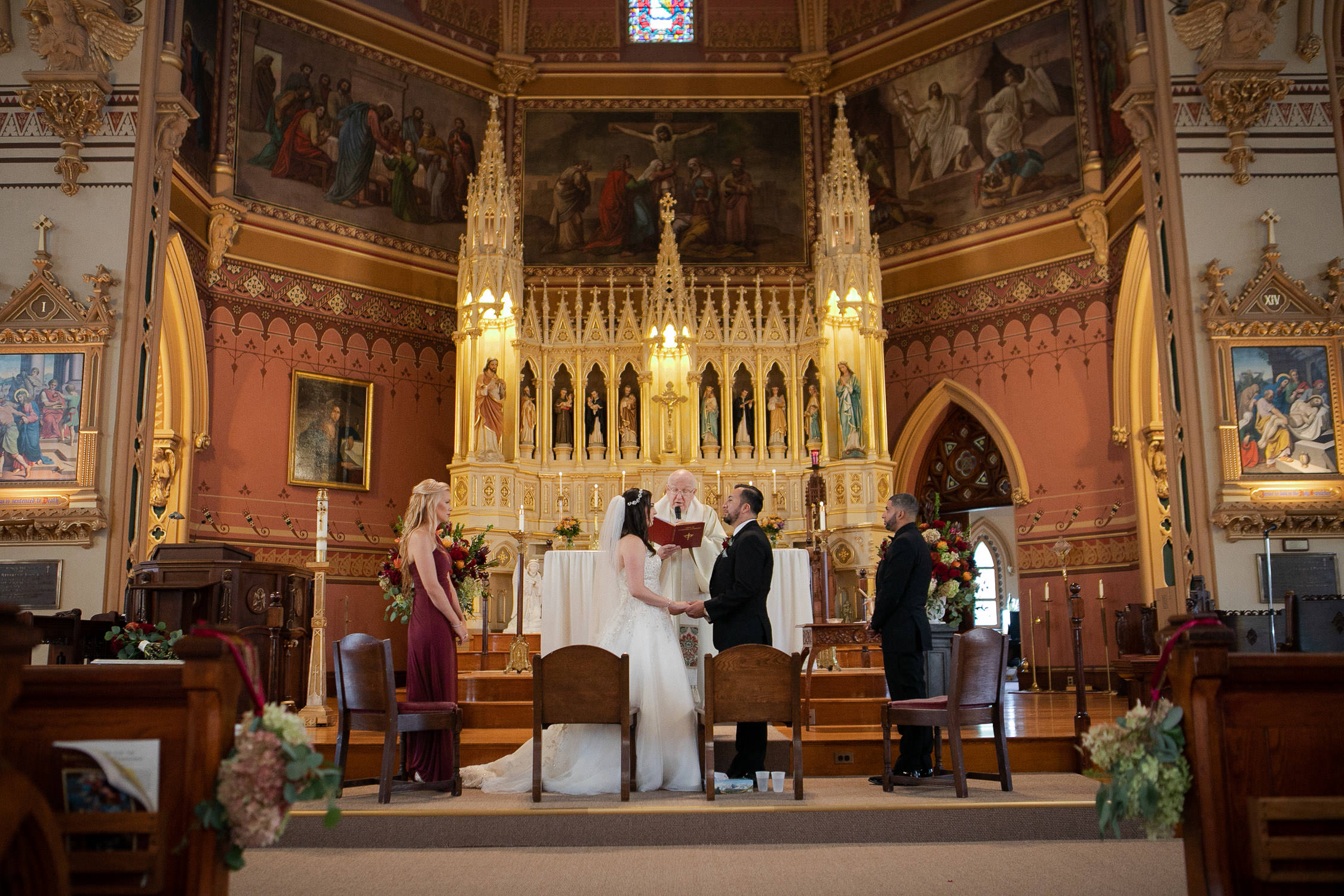 St John's Church Clinton MA, vows during a wedding, gorgeous altar