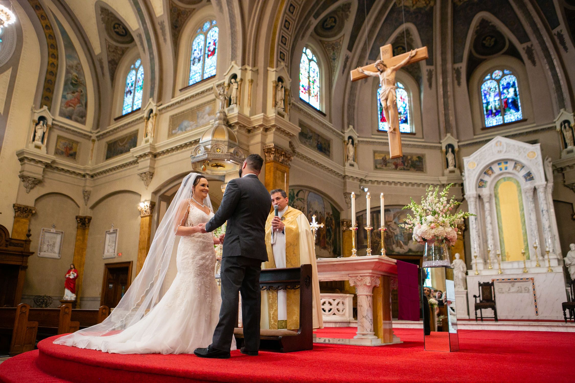 Worcester wedding photographer - Holy Family Parish at St. Joseph's Church , bride and groom exchanging vows