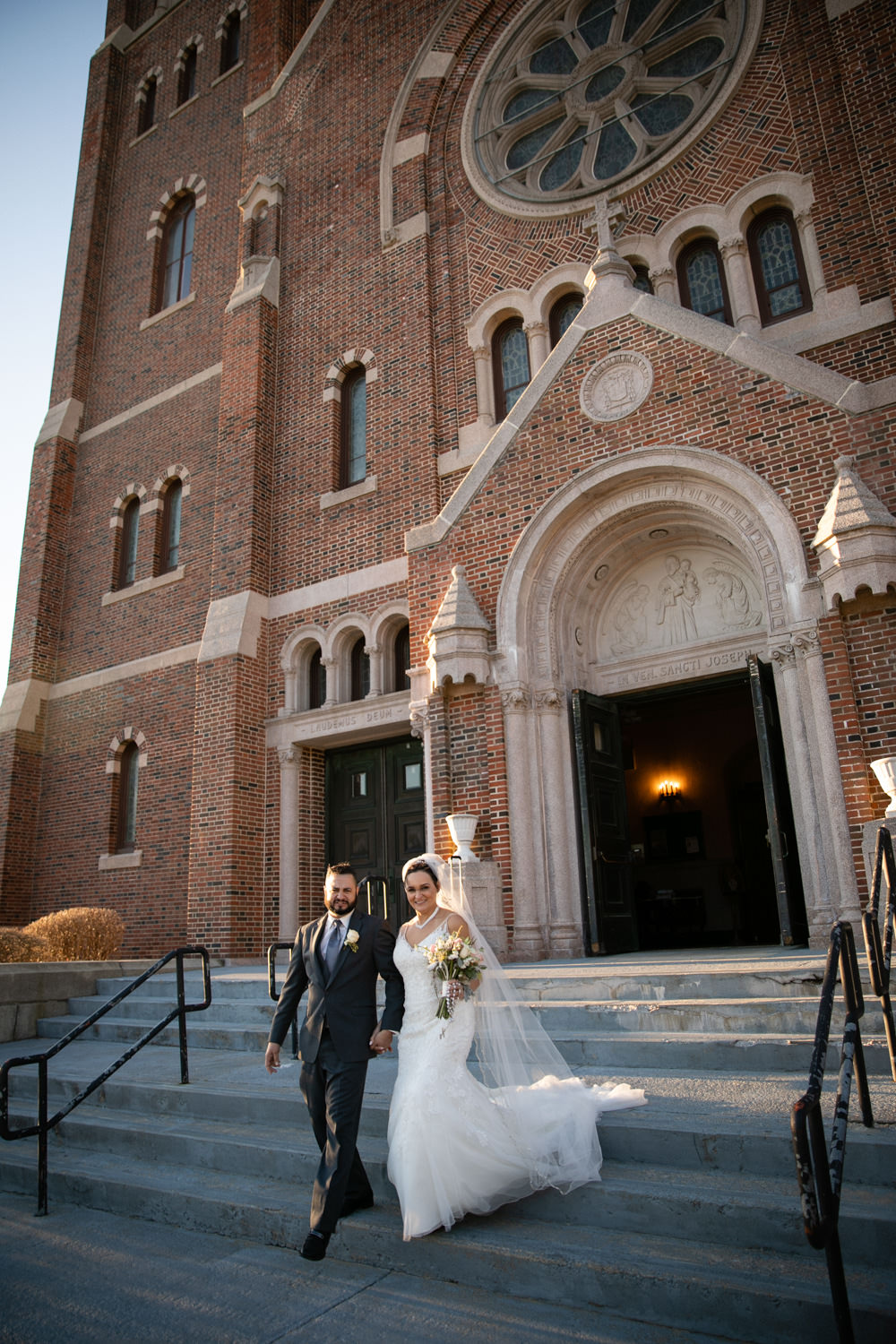 Bride and Groom exiting the Holy Family Parish at St. Joseph's Church wedding
